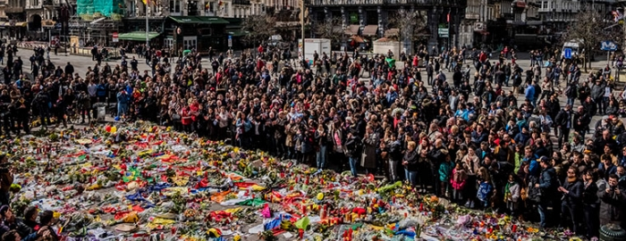 People gather around a makeshift memorial for victims of Tuesday's attacks, during a peace rally in Brussels, March 27, 2016
