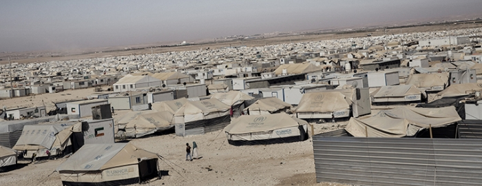 A view of the Zaatari refugee camp in Jordan, June 26, 2014. A number of forward-thinking aid workers are looking at refugee camps like Zaatari, which has effectively become an informal city, as potential urban incubators, places that can develop and benefit the host countries. (Adam Ferguson/The New York Times)