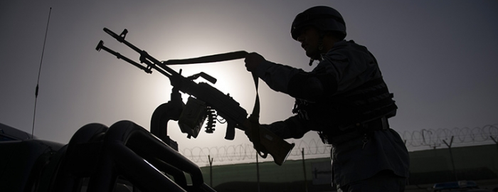 A police officer prepares for a patrol in Kabul, Afghanistan