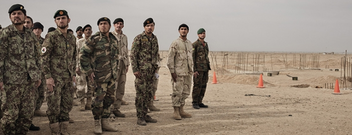 Members of the Afghan Army stand in formation during training, overseen by U.S. Army soldiers at Camp Bastion in Helmand Province, Afghanistan, March 22, 2016. President Barack Obama inched closer recently to allowing American forces to once again directly battle the Taliban, loosening restrictions on airstrikes and on ground combat in support of Afghan forces, the administration said on June 10.