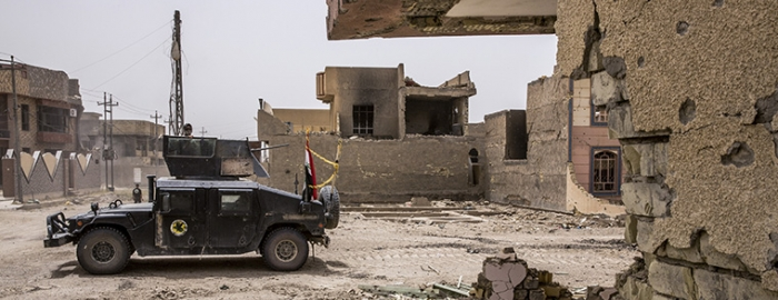 Iraqi counterterrorism forces move through the heavily damaged Shuhada neighborhood in Fallujah, Iraq, June 18, 2016. The Islamic State's suicide attack in Baghdad in July, officials say, foreshadows the violence it will unleash as it reverts to its guerrilla roots. A return to guerrilla warfare in Iraq, while the United States and its allies still combat the Islamic State in Syria, would pose one of the first major challenges to the next American president. (Bryan Denton/The New York Times)