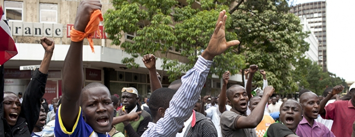 Supporters of Raila Odinga, Kenya's prime minister and a presidential candidate, stage a protest outside the Supreme Court in Nairobi, Kenya, March 30, 2013. The court announced Saturday that the March presidential election results are valid and that Uhuru Kenyatta has won.