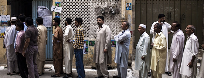 Men line up outside a polling station in Rawalpindi, Pakistan, May 11, 2013. Pakistanis went to the polls in high numbers on Saturday, in a vote that carried the historic prospect of the country's first fully democratic political cycle despite fresh violence from Taliban insurgents. (Diego Ibarra Sanchez/The New York Times)