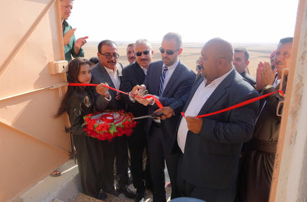 The author, Knox Thames, cuts the ribbon of the reconstructed Yazidi temple in Khoshaba, Iraq, September 2017.