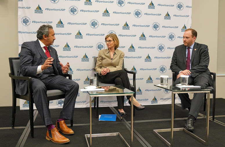 Representatives Ami Bera (D-CA), left, and Lee Zeldin (R-NY), right, talk with U.S. Institute of Peace President Nancy Lindborg, May 10, 2019.