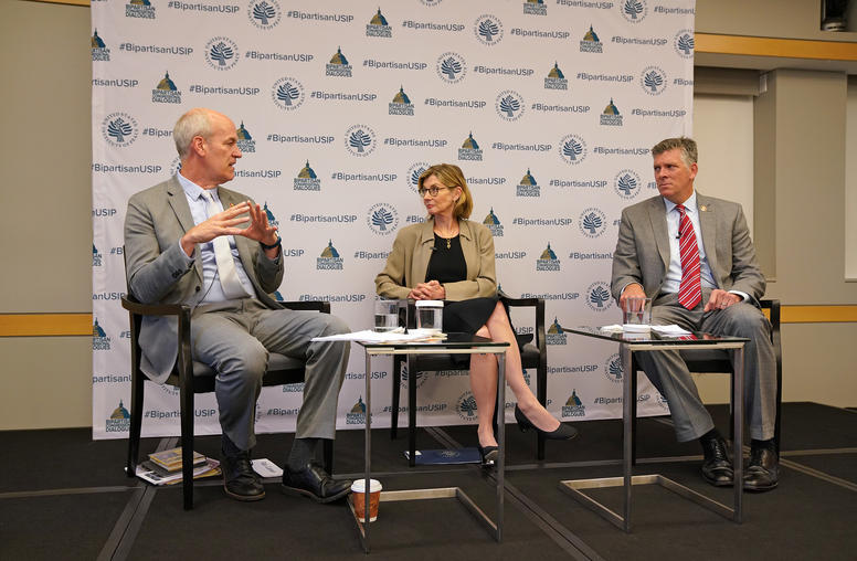 Pictured left to right, Rep. Rick Larsen, Nancy Lindborg, Rep. Darin LaHood